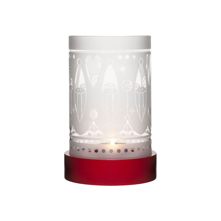 Minimalist and elegant, this glass tealight holder has a joyful yuletide pattern that sets a playful holiday tone on any tabletop or fireplace mantel. Perfect for illuminating the holiday tabletop thro...  Find the White Jul Tealight Holder, as seen in the Have a Very Scandinavian Christmas Collection at http://dotandbo.com/collections/scandinavian-christmas?utm_source=pinterest&utm_medium=organic&db_sku=SAG0074
