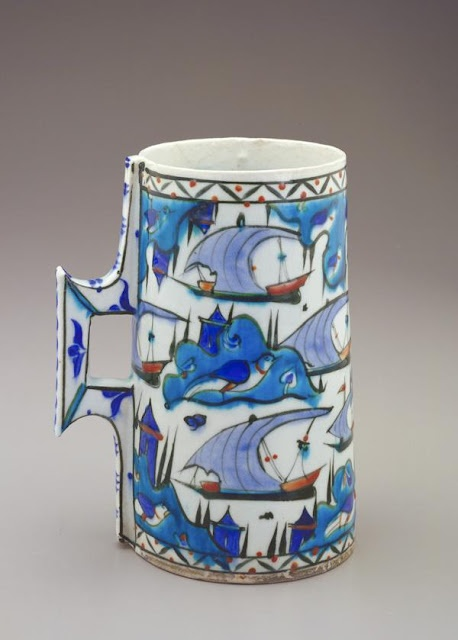 Tankard. Iznik,  Turkey, late 16th century (Ottoman period).  The boats on this drinking vessel sail past islands accentuated by small castles, large birds, and pairs of cypress trees.  Photograph and description taken from Freer and the Sackler (Smithsonian) Museums.