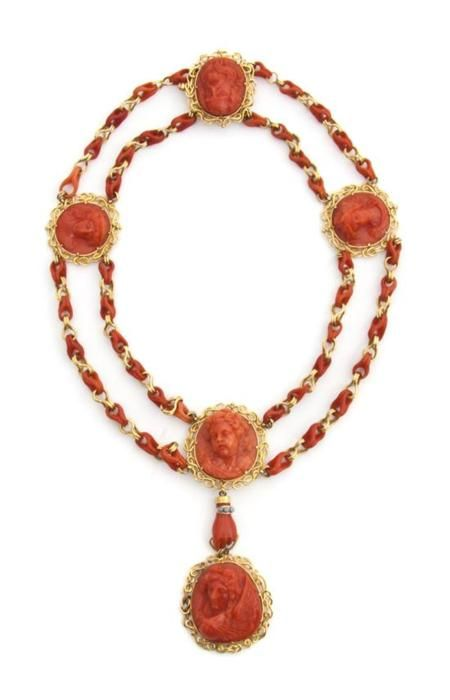 A Victorian coral cameo necklace with an amazing coral and gold chain.