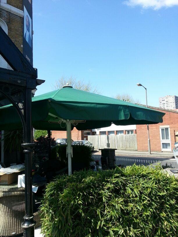 the giant umbrella at the duke of cambridge a youngs pub in battersea has: metre giant umbrella