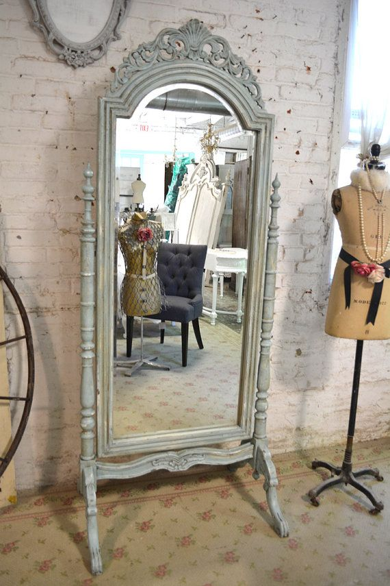 Amazing romantic French mirror!      FEATURES: Fancy French lines standing mirror    FINISH: Painted with our cottage white and distressed just