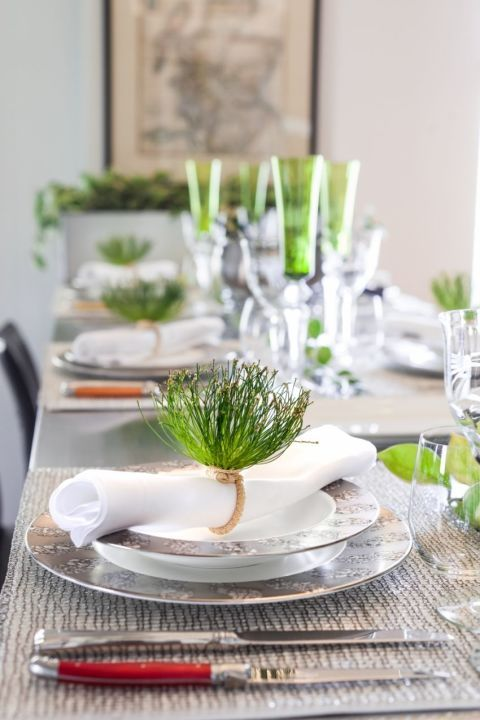 """""""Instead of opting for the traditional Easter pinks and purples, I work with green to play off of the beginning of Spring. Accommodating my large family leaves little table room for any aesthetic additions like centerpiece items, so I try to pull in as much color as I can from the items that absolutely have to be there. When working with your everyday white china, you can still have a completely over-the-top tablescape by using colorful essentials — flatware, napkin rings, crystalware, and…"""