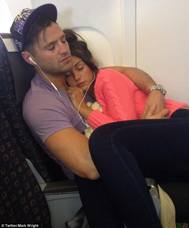 Inseparable: Michelle Keegan and Mark Wright struggled to untangle themselves even while thousands of feet up in the air as they caught a flight together on Tuesday