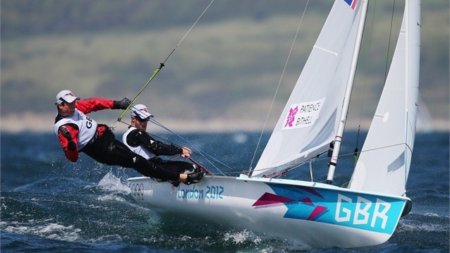 Luke Patience (black) and Stuart Bithell (red) of Great Britain compete in the men's 470 Sailing on Day 6 of the London 2012 Olympic Games at Weymouth & Portland.
