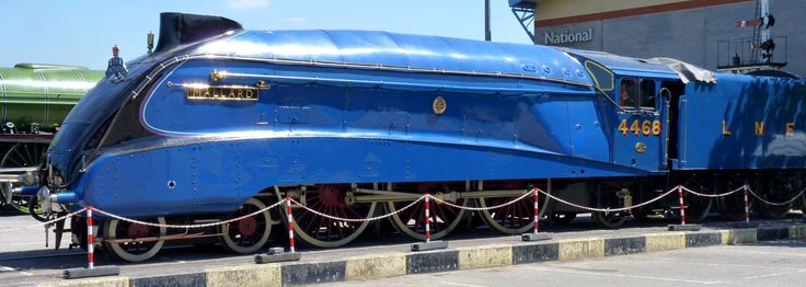 """The British London and North Eastern Railway Class A4 4-6-2 Pacific steam locomotive Number 4468, the """"Mallard,"""" built in 1938. Unlike most streamlined steam locomotives of its time, its design was calculated to meet the best known aerodynamic requirements of the day, including wind-tunnel testing; it set the speed record for steam on July 3, 1939. Wikimedia Commons photo by Sorry23sorry, shared under Creative Commons license, details @ http://creativecommons.org/licenses/by-sa/3.0/deed.en ."""