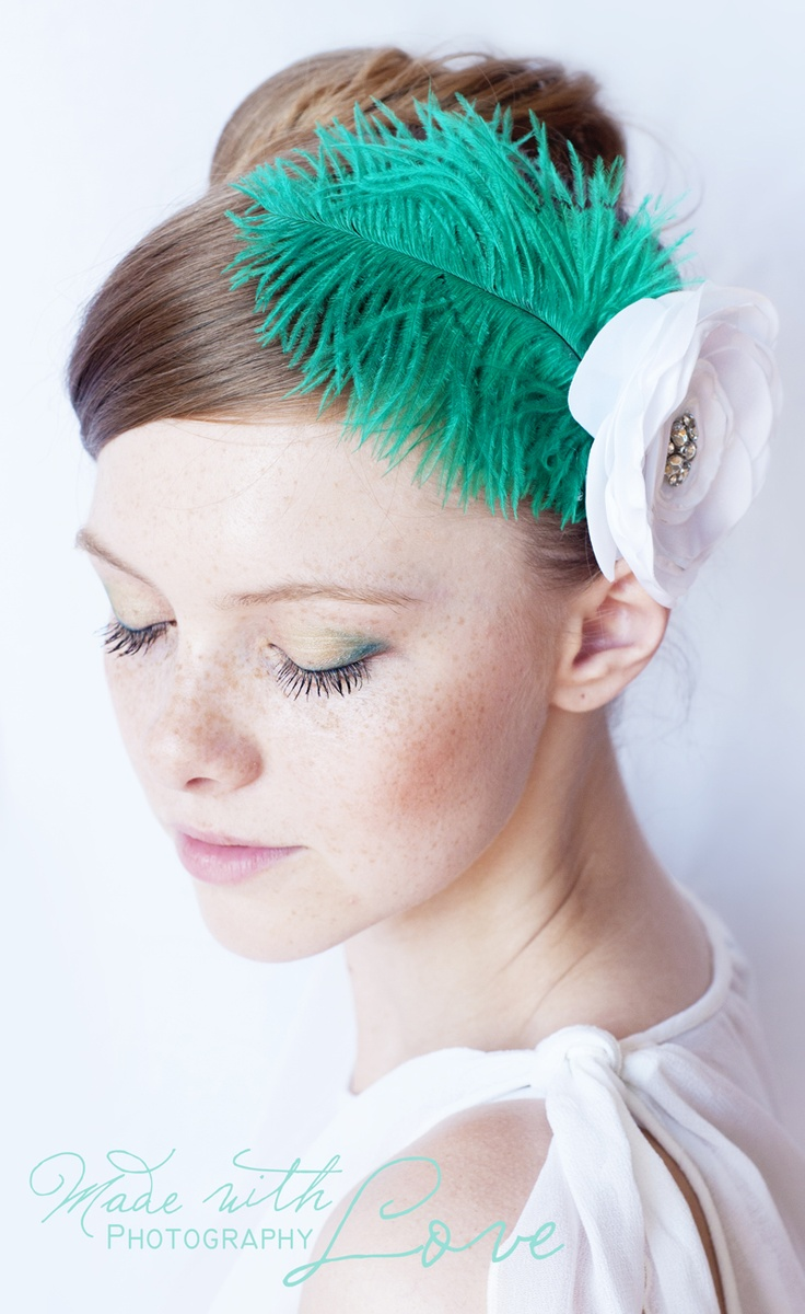 emerald with white fascinator