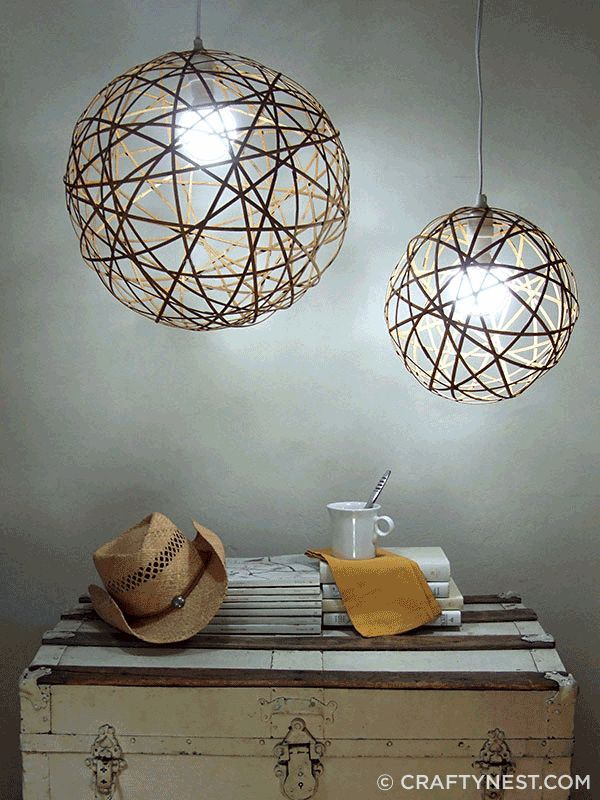 Bamboo orb pendant lamp made by taking apart bamboo placemats and making orbs with wood glue and pegs