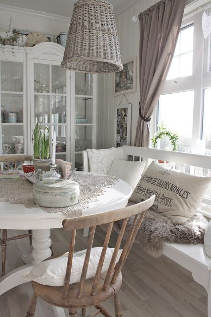 Shabby Chic beach house. Love the white furniture and kitchen table bench. Would def put the trash bin back on the floor where it belongs.