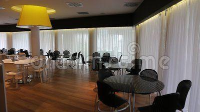 Lounge bar - yellow light pylon and modern furniture.