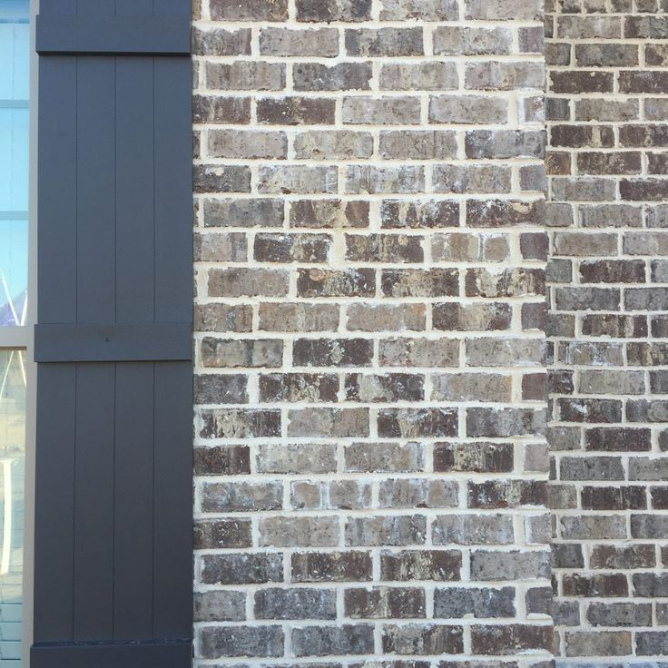 Marshton Queen brick with Ivory Mortar and dark brown wood shutters. Brick by Pine Hall Brick.