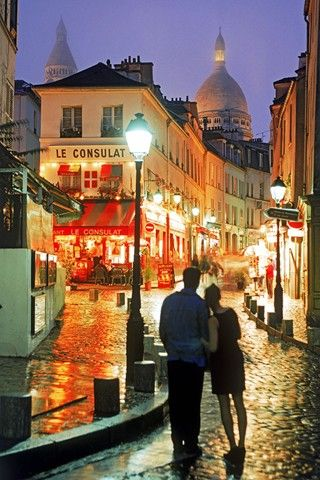 Night time on cobble stone streets in Paris.