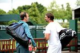 Former competitors Goran Ivanisevic and Greg Rusedski have a chat