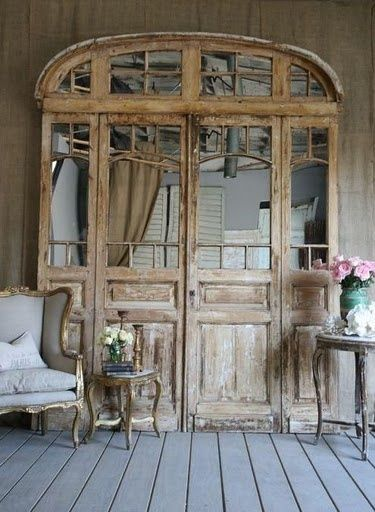 vintage door turned into mirrored art. - front door area?????