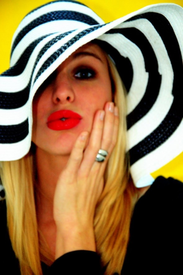 Black & White striped hat, red lips, yellow background. Madstyling