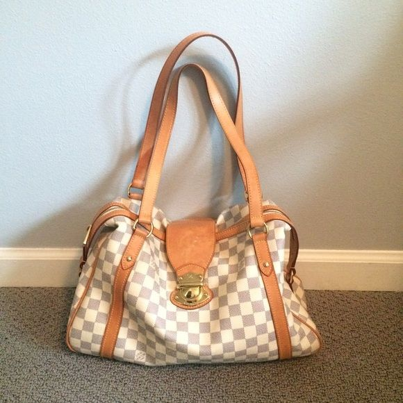 Louis Vuitton blue/white checkered bag Authentic, sturdy, beautiful bag. Zip and buckle closure keeps everything inside safe! Great shoulder bag and always the receiver of compliments! Excellent used condition, a few marks, but not noticeable (see last picture). No rips or tears. Beautiful buckles on the sides as well. This bag will last a lifetime! You need this bag! Louis Vuitton Bags Shoulder Bags