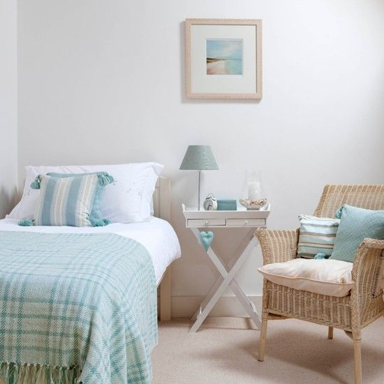Coastal-inspired aqua bedroom. Make a small bedroom appear larger by choosing a pale look. Add just a hint of colour with accessories in a muted colour. Simple pieces of furniture create a relaxed vibe in this bedroom. Bedlinen in a pastel green palette bring the fresh feeling of the outdoors into the room.
