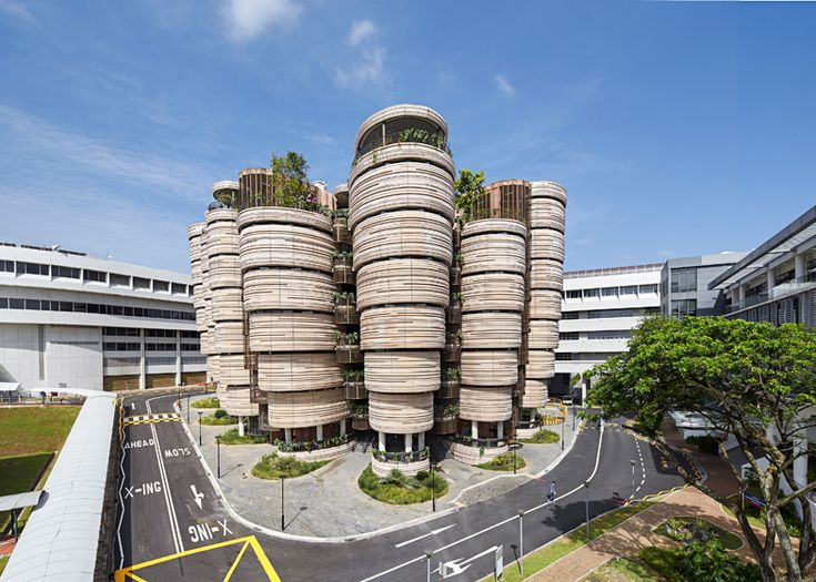 Designer Thomas Heatherwick just completed construction on a cluster of 12 parsnip tornado-shaped towers for the Nanyang Technological University in Singap