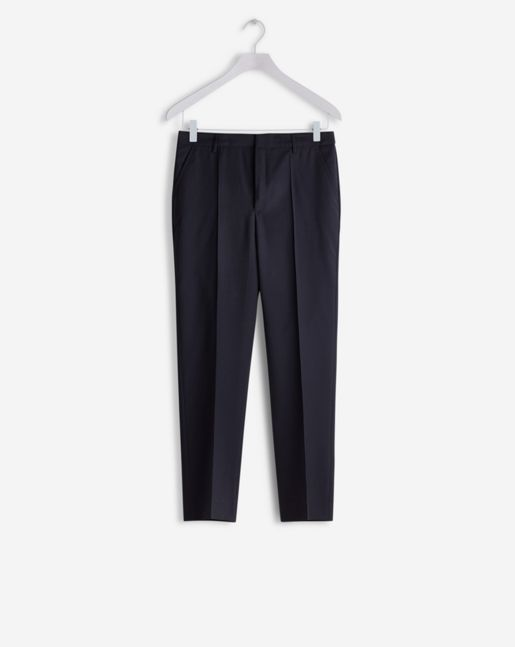 A looser slightly carrot shaped fit with elastic at waist and sewn press creases. Perfectly combines sporty ease with tailored style. Wear with masculine flats for a look that is both relaxed and well dressed. <br /><br /> This is a sustainable style, d