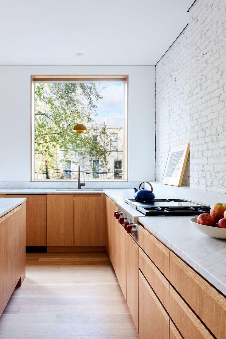 Cuisine devant fenêtre, baie vitrée : inspiration lumineuse
