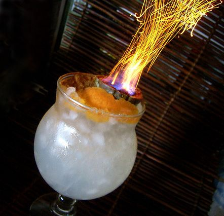 The Volcano Queen.  Talk about a tiki drink! Cinnamon sprinkled on the burning booze is how you create the fireworks effect.