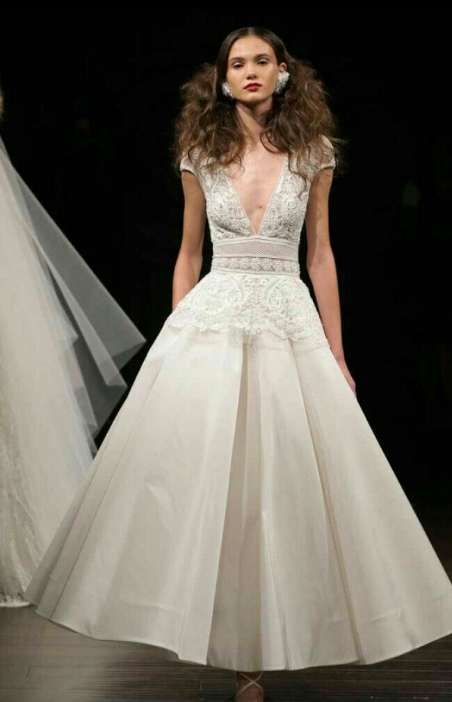 Perfect Naeem Khan us plunging wedding dress mixes both sexy and sweet in one of the the best short wedding dresses from Fall Bridal Week keep it short and sweet