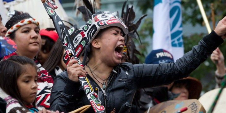 A First Nations woman cheers while taking part in the Walk for Reconciliation in Vancouver, B.C., on Sunday September 22, 2013.  Article on government's response to crisis on First Nation reserves.