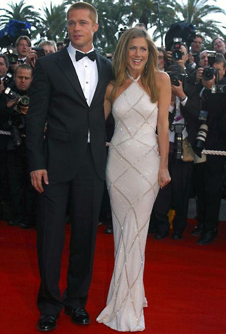 "Brides.com: Jennifer Aniston's Wedding Dress Style. No movie industry event is more glamorous than the Cannes Film Festival, where no actress in 2004 was more glamorous than Aniston (attending with then-husband Brad Pitt for the premiere of ""Troy"") in an Atelier Versace gown. The halter neckline and sleek silhouette offered a modern, youthful vibe to the traditional Old Hollywood look. See halter wedding dresses"