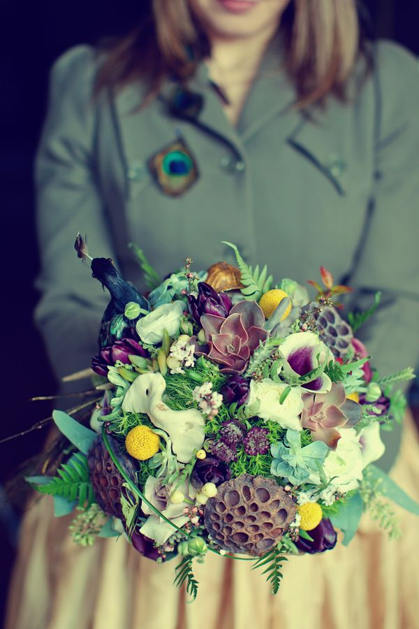 butterflies, succulents, and peacock feather bouquet by flowerful events, photo by vanessa joy photography