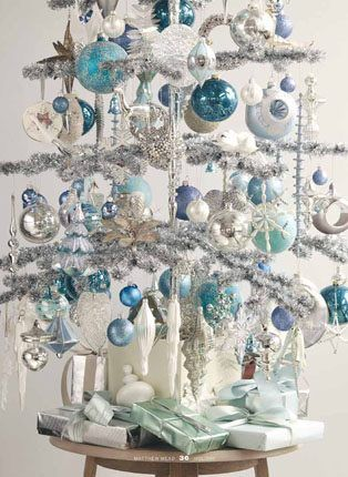 Blue ornaments on white goose feather tree