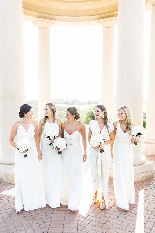 Bridesmaids in mismatched long white dresses by @joannaaugust | @THEGROVERS | Brides.com