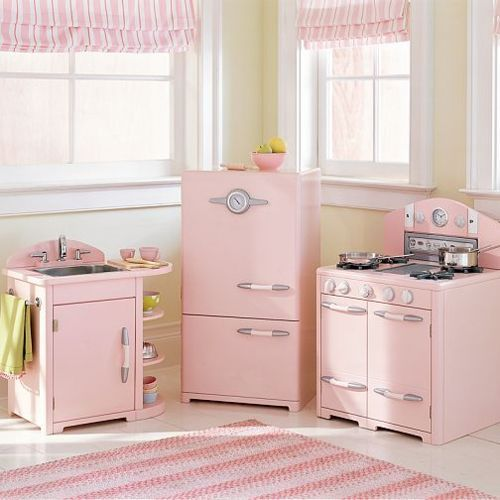 A very pink kitchen from Better Homes and Gardens, 1952. It's actually a childs' play kitchen