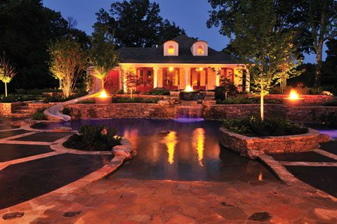 The use of fire features and landscape lighting make for a truly awesome sight at night. J. Brownlee Pool & Landscape; Photography by Terry Sweeney http://www.poolspaoutdoor.com/pools/inground-pools/articles/ultimate-home-resort.aspx