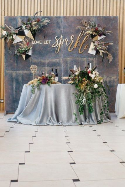 an aged metal backdrop with geometric pieces, blooms and herbs for a bold look