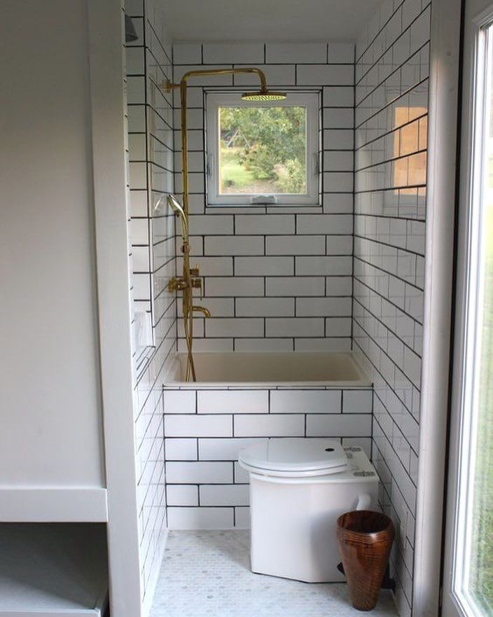 PERFECT! This is Exactly what I wanted to do! A high tub I can sit in with my legs crossed and have the water up to my chest white subway tile with grey grout and gold & wood accents!! #tiny #tinyhouse #tinyhousemovement #tinyhouseliving #tinyhouseonwheels #tinyhousebuild #tinyhouselife #tinyhousedesign #tinyhouseproject #tinyhousefamily #tinyhouseideas #tinyhouseinspiration #tinyhome #tinyhouseonwheels #thow by tinyvegandweller