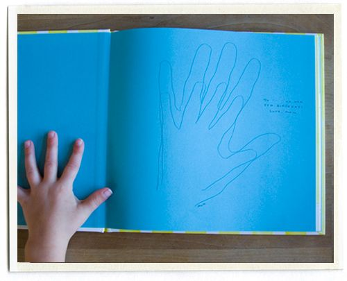 you and kiddo trace your hands the first time you read the book together