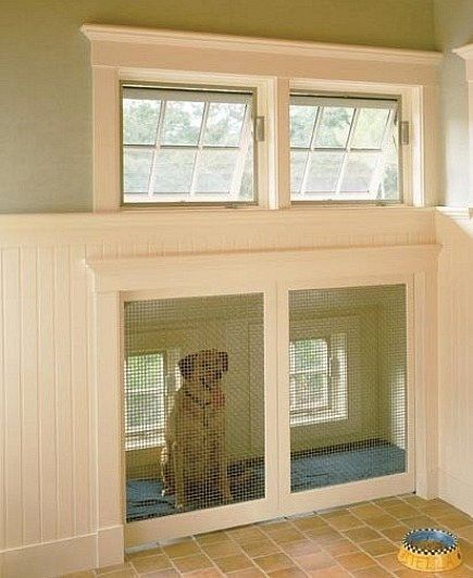 Built-in dog house with doggie door to outside- would be awesome in a mud room. Clever