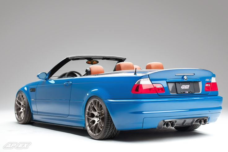 "Rear 3/4 view of a Laguna Seca Blue BMW E46 M3 Convertible with APEX 19"" PS-7 wheel fitment"