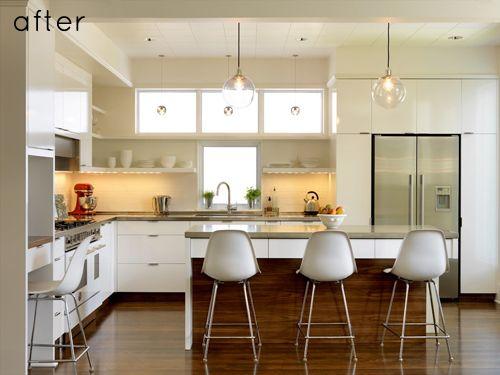 white kichen wooden floor. Love the handles.