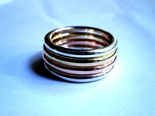 Unisex Band 4pcs Ring, Sterling Silver, Platinum Plated, Yellow Gold Plated, Red Gold Plated Konstantis Jewelry http://www.amazon.com/dp/B00OO0L3IK/ref=cm_sw_r_pi_dp_YQsUvb170HVMC