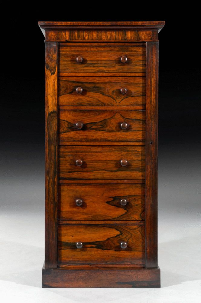England Circa 1825 The Wellington chest is of good proportions with the original rosewood turned handles and cedar lined drawers. It also has the original locks and locking pilaster. It is really unusual to see a wellington chest of this size from the Regency period.