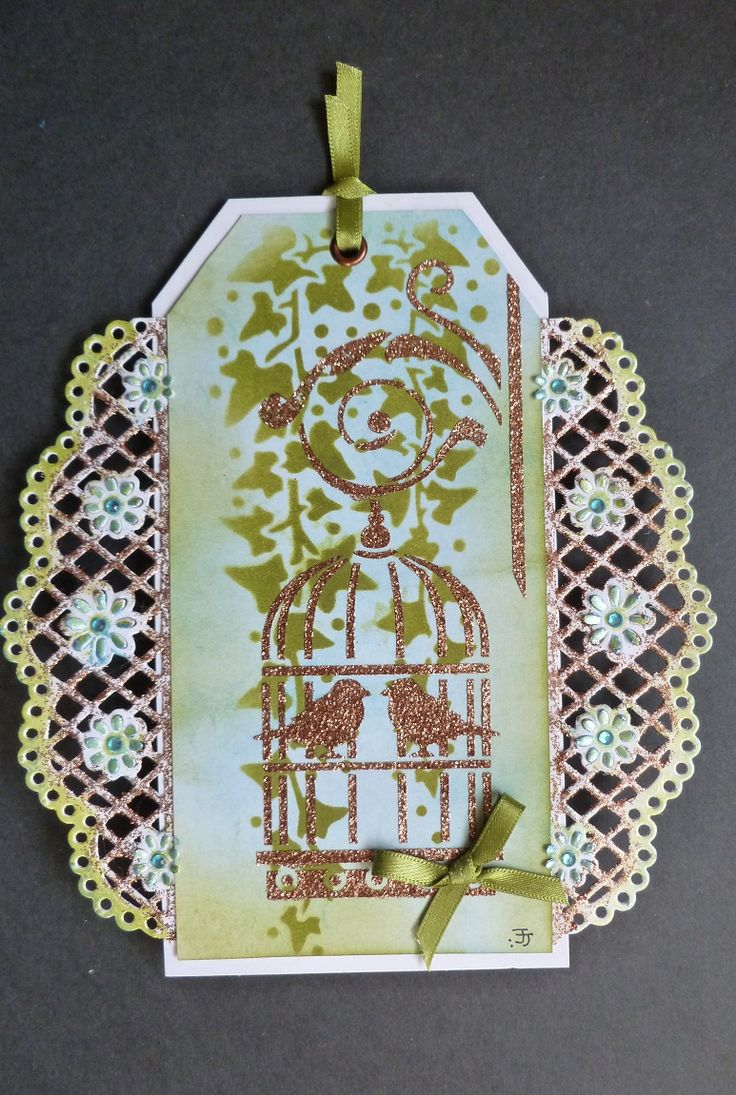 'Love Birds' Tag - Imagination Craft's- Birdcage & Ivy Leaf panel stencils.  Lt. Copper Sparkle Medium.  Metal spatula.  Magi-bond glue.  Apple Green & Sky Starlight Waxes.  Peeled paint & Broken china Distress inks.  Copper eyelet.  Crafter's Companion edgeables die - Doily Lattice.   February 2017.   Designed by Jennifer Johnston.