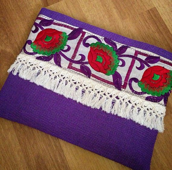 Purple Floral Clutch, Bohemian Clutch, Boho Bag, Fashion Bag, Womens handbag, gift for her, Clutch purse, Ethnic Clutch, Handmade gift  A fashion statement that everyone will swoon over! This boho bag will bring elegance to your style. It will be chic with jeans or dresses and you may use this clutch bag both day and night. This clutch bag is perfectly handmade with high quality purple jute fabric. Designed with a silk bohemian embroidery and a tassel. Clutch has a silk satin interfacing…