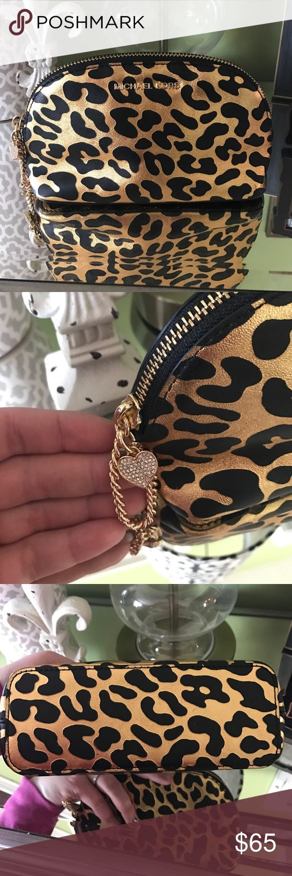 MICHAEL Michael Kors Alex Medium Travel Pouch Top zipper closure. Chain strap zipper pull with jeweled heart. Exterior boasts brand name hardware. Flat bottom. Lined interior features slip pocket. Leopard pattern. Used a couple of times. 🚫NO trades....Looking to sell. MICHAEL Michael Kors Bags Cosmetic Bags & Cases