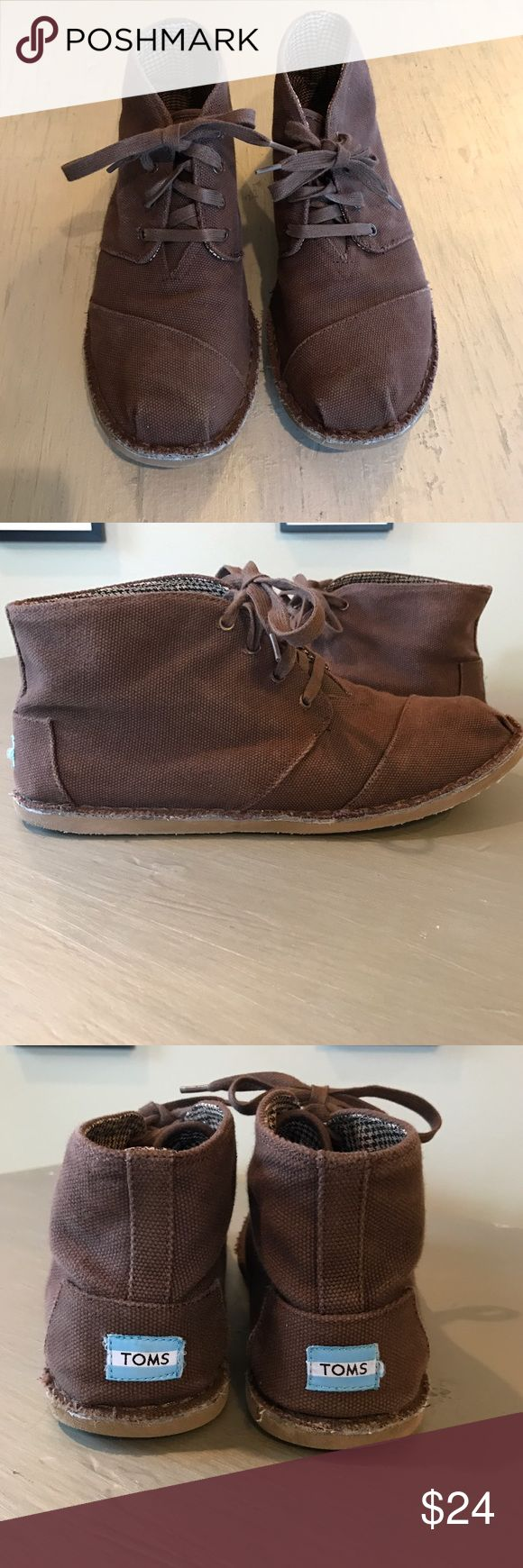 Men's TOMS Lace-up Brown Short Boots My husband has worn these a handful of times but these are still in good condition. Dark brown canvas/burlap material. 4 eye lace up style short boots. Raw edges around sole. Labeled as a men's 12. TOMS Shoes Boots