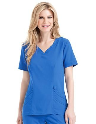 """Be the center of attention with this beautiful scrub top!  Everything you desire, this top has it all! Designed with silk-like softness and stylish durability this scrub top will be your ultimate favorite!  This chic top features a sweetheart-shaped neckline, two double patch pockets, and both front & back waist darts perfect for shaping your figure. You will love this soft-to-the-touch, easy care fabric.54% Rayon/44%Polyester/2% Spandex.XS-3XL.Medium length: 26 3/8"""""""