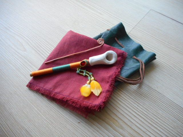 Pipe made with white clay and bamboo mouthpiece that is decorated with cotton thread, glass beads, green agate, guairuro seed and parrot feathers. The red cloth has the function of protecting and preserving the stove once inserted in the Medicine Bag, which is made of green leather. The brush is copper. www.facebook.com/MotherofWater