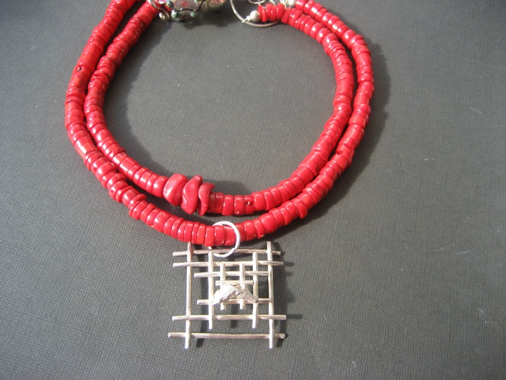 coral with silver pendant