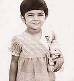 The cuddly Sushmita Sen holding a doll as a kid