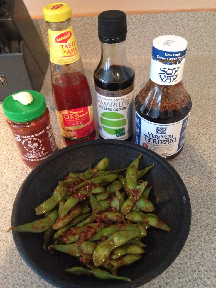 RA Sushi Garlic Edamame Copy! Been craving this for weeks. Boil 10oz bag Edamame for 5 minutes. At same time, heat 1T olive oil & 1T Sesame Oil. Add 2T minced Garlic. Cook for 3 minutes over medium. Add 1T of the 3 sauces on left and 3T of Teriyaki.  Spicy and delicious!