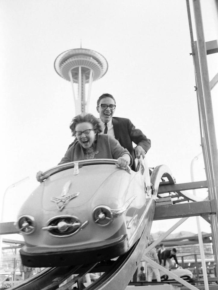 Black and white. Very old park. Lame ride. But still looks fun because of the expression on their faces.
